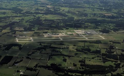 View of airfield from the west on departing airliner with underconstruction taxiway