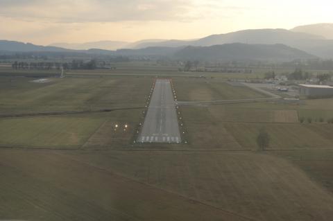 Short final of Runway 25. 1000m long, 23m wide, concrete runway.