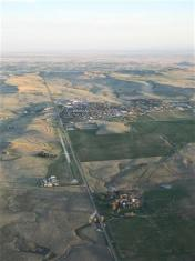 Calhan airport & town. Ridge with wind turbine farm is south.